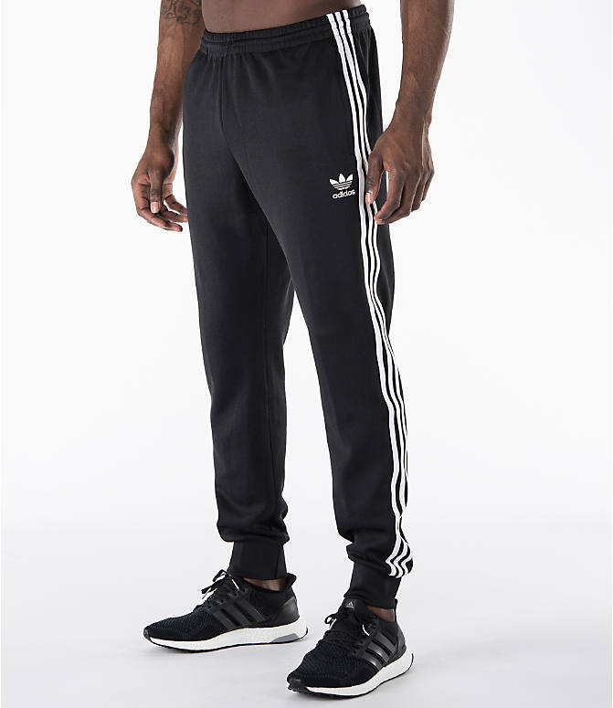 Front Three Quarter view of Men's adidas Originals SST Cuffed Jogger Pants in Black