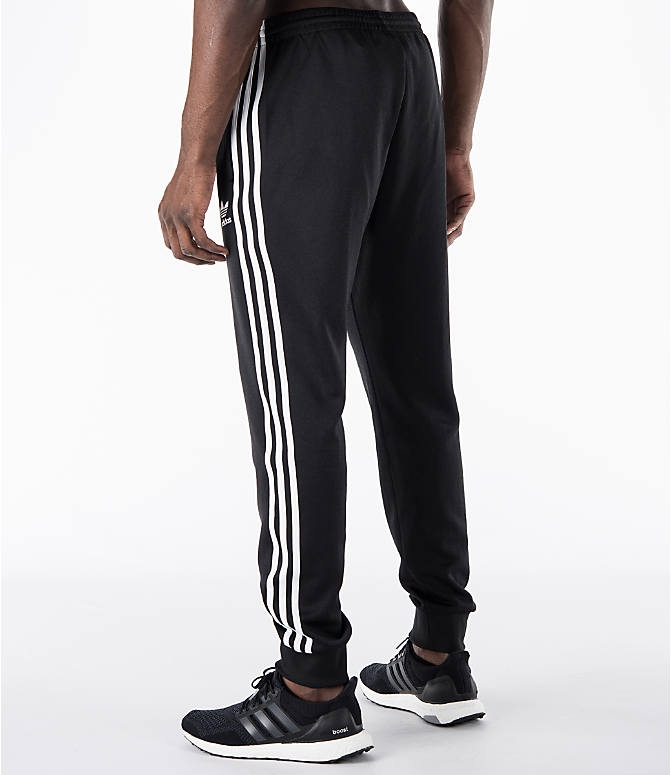 Back Left view of Men's adidas Originals SST Cuffed Jogger Pants in Black