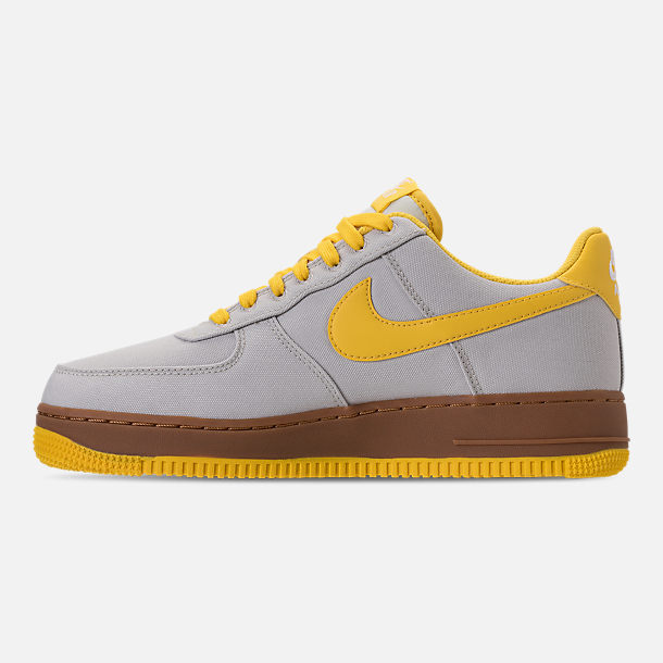Left view of Men's Nike Air Force 1 '07 TXT Casual Shoes in Light Bone/Tour Yellow/Summit White