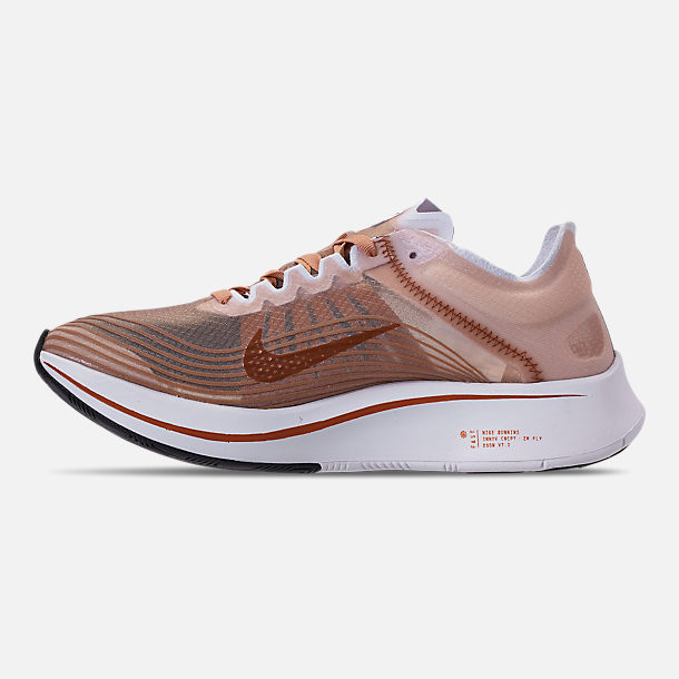 Left view of Women's Nike Zoom Fly SP Running Shoes in Dusty Peach/Guava Ice