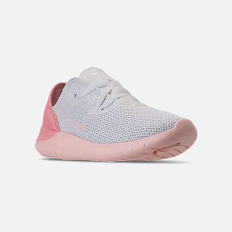 Three Quarter view of Women's Nike Hakata Casual Shoes in White/Bleached Coral/Sunset Tint