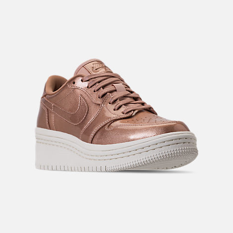 Three Quarter view of Women's Air Jordan Retro 1 Low Lifted Casual Shoes in Metallic Red Bronze/Metallic Red Bronze