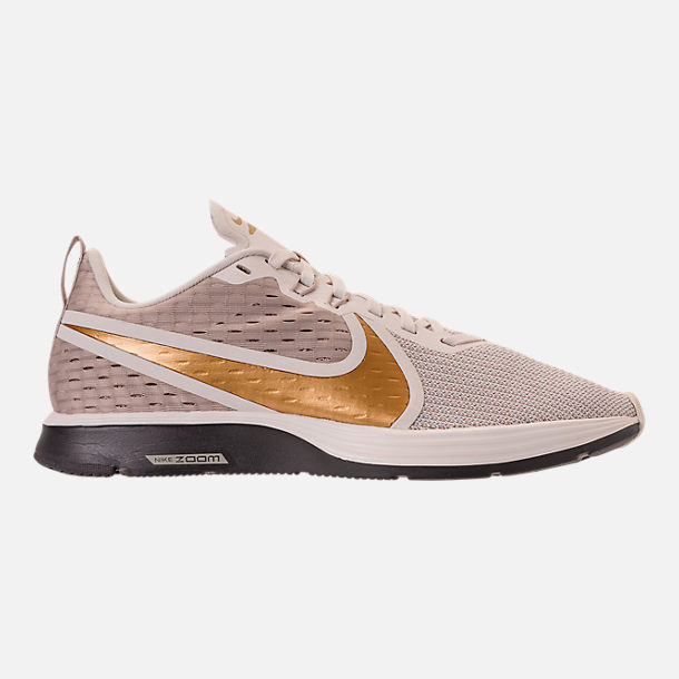 92afa0dfaadf6 Right view of Women s Nike Zoom Strike 2 Running Shoes in String Metallic  Gold
