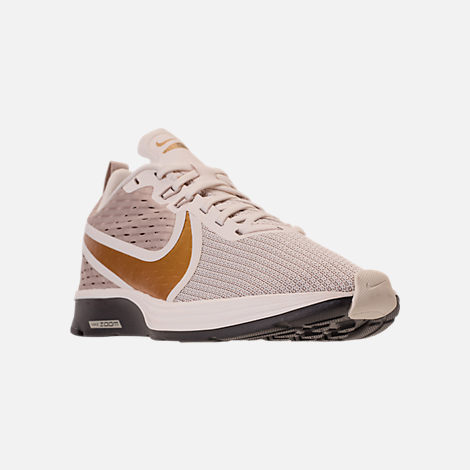 08f22825cc53 Three Quarter view of Women s Nike Zoom Strike 2 Running Shoes in  String Metallic Gold