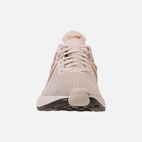 d0bf3933a9ac4 Front view of Women s Nike Zoom Strike 2 Running Shoes in String Metallic  Gold