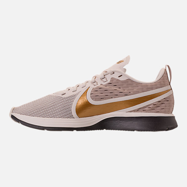 e7f265c7b95dd Left view of Women s Nike Zoom Strike 2 Running Shoes in String Metallic  Gold