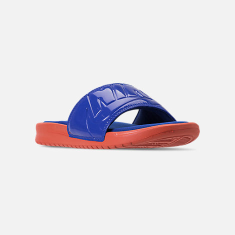 Three Quarter view of Women's Nike Benassi Just Do It Ultra SE Slide Sandals in Vintage Coral/Racer Blue