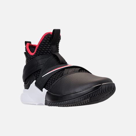 Three Quarter view of Men's Nike LeBron Soldier 12 Basketball Shoes in Black/University Red/White