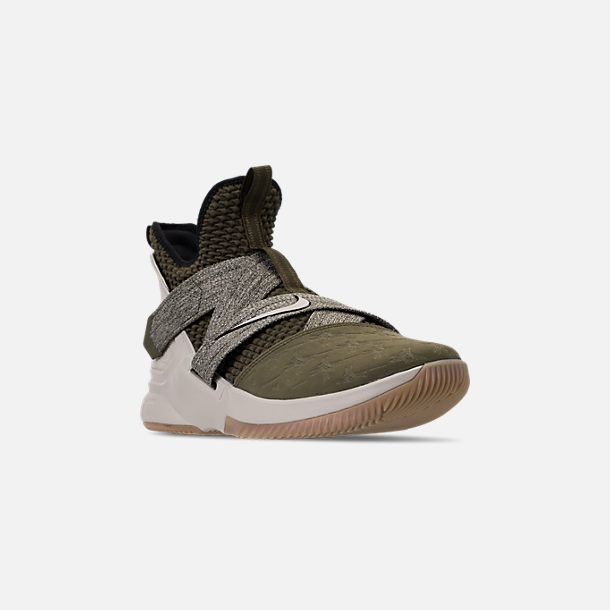 3221dd2efcc72 Three Quarter view of Men s Nike LeBron Soldier 12 Basketball Shoes in  Olive Canvas String