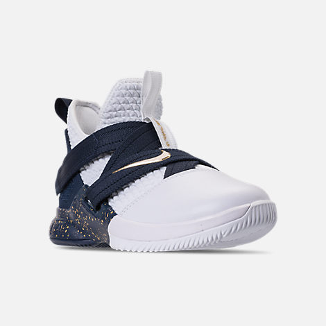 Three Quarter view of Boys' Grade School Nike LeBron Soldier 12 SFG Basketball Shoes in White/White/Midnight Navy/Mineral Yellow