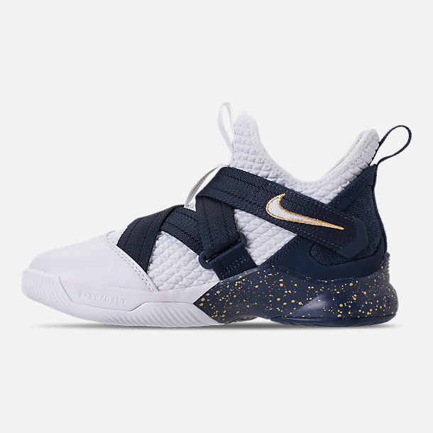 Left view of Boys' Grade School Nike LeBron Soldier 12 SFG Basketball Shoes in White/White/Midnight Navy/Mineral Yellow