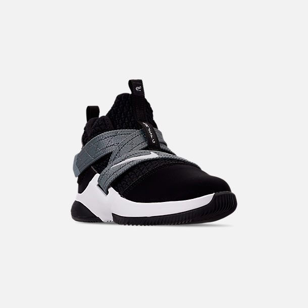 Three Quarter view of Boys' Little Kids' Nike LeBron Soldier 12 SFG Basketball Shoes in Black/White - Raid