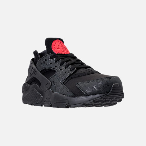 Three Quarter view of Men's Nike Air Huarache Run Floral Casual Shoes in Black/University Red