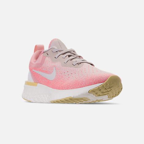 Three Quarter view of Women's Nike Odyssey React Running Shoes in Desert Sand/Sail/Light Atomic Pink