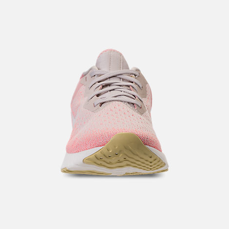 Front view of Women's Nike Odyssey React Running Shoes in Desert Sand/Sail/Light Atomic Pink