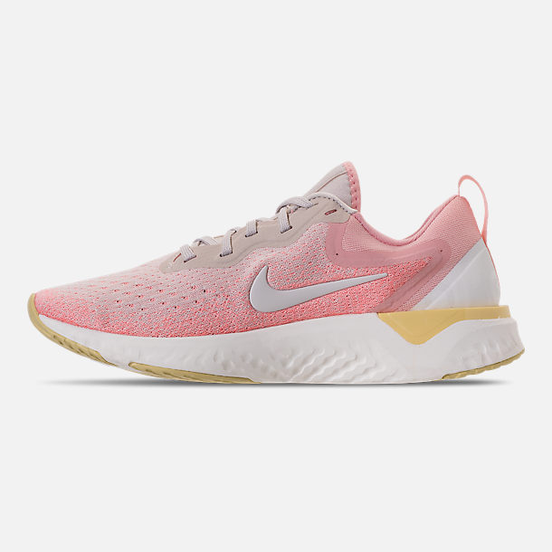 Left view of Women's Nike Odyssey React Running Shoes in Desert Sand/Sail/Light Atomic Pink