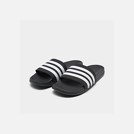 Three Quarter view of Women's adidas adilette Cloudfoam Plus Slide Sandals in Black/White
