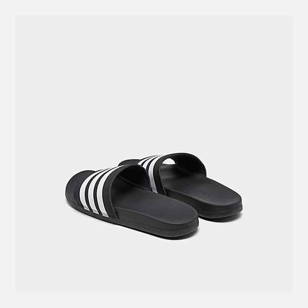 Left view of Women's adidas adilette Cloudfoam Plus Slide Sandals in Black/White