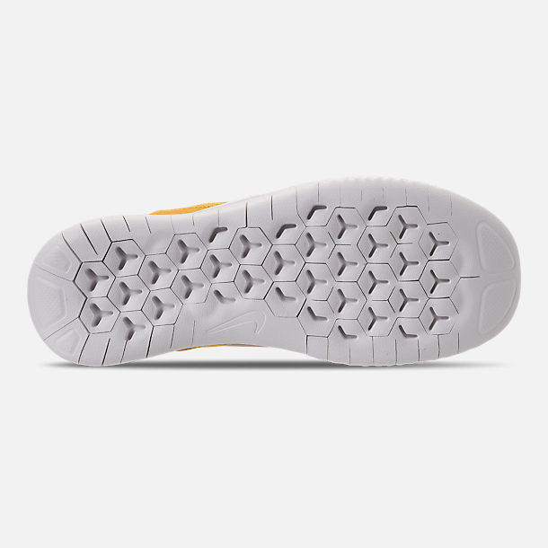 Bottom view of Women's Nike Free RN 2018 Wild Suede Running Shoes in Desert/Oil Grey/Yellow Ochre
