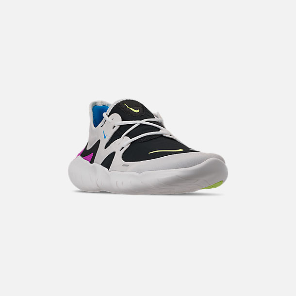 24a8c8d368a Three Quarter view of Men s Nike Free RN 5.0 Running Shoes in White Summit  Volt