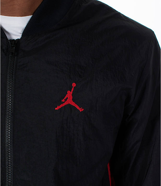 Detail 1 view of Men's Jordan Sportswear Rings Track Jacket in Black/Gym Red