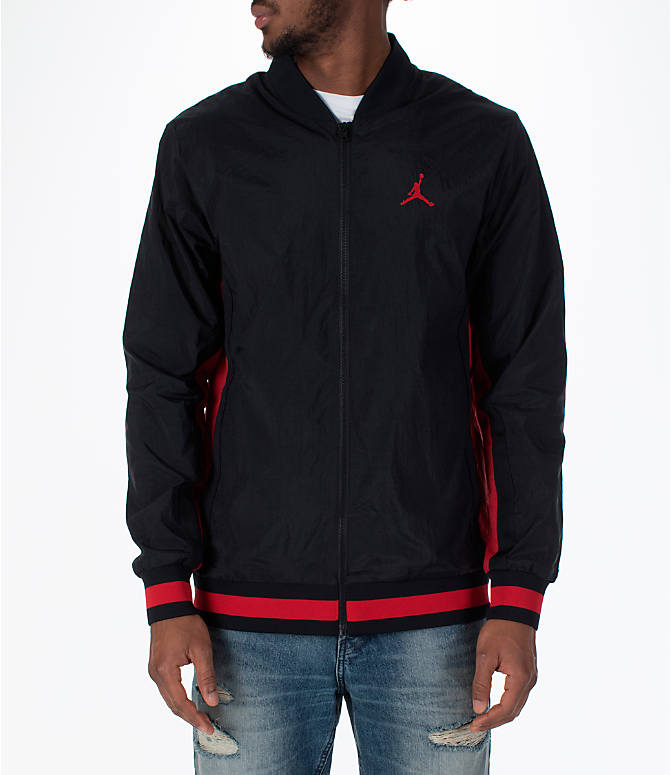 Front view of Men's Jordan Sportswear Rings Track Jacket in Black/Gym Red