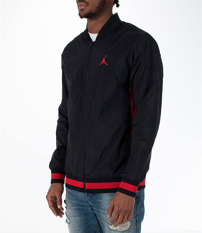 Front Three Quarter view of Men's Jordan Sportswear Rings Track Jacket in Black/Gym Red