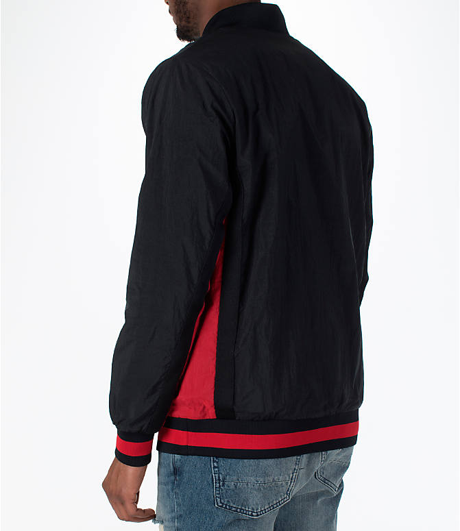 Back Left view of Men's Jordan Sportswear Rings Track Jacket in Black/Gym Red