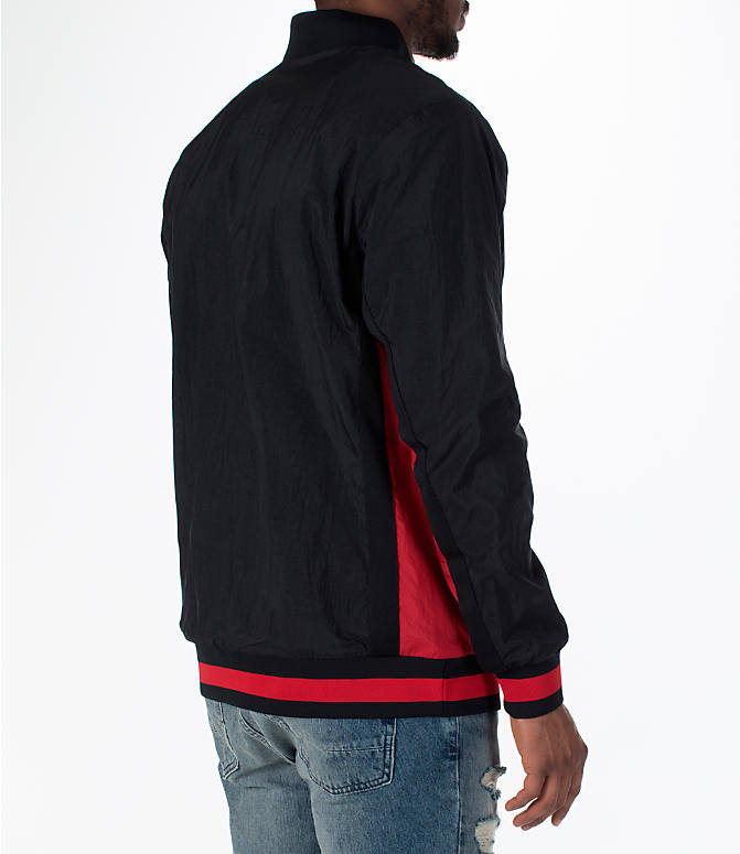 Back Right view of Men's Jordan Sportswear Rings Track Jacket in Black/Gym Red