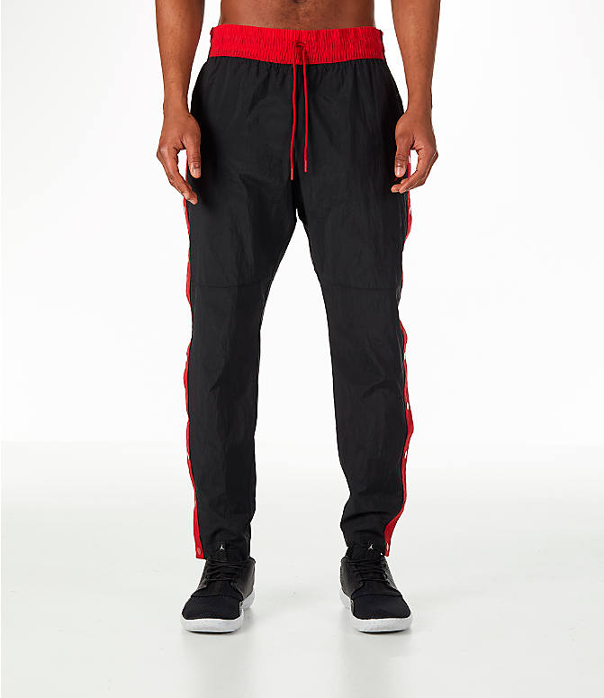 Front Three Quarter view of Men's Jordan Sportswear Rings Track Pants in Black/Gym Red