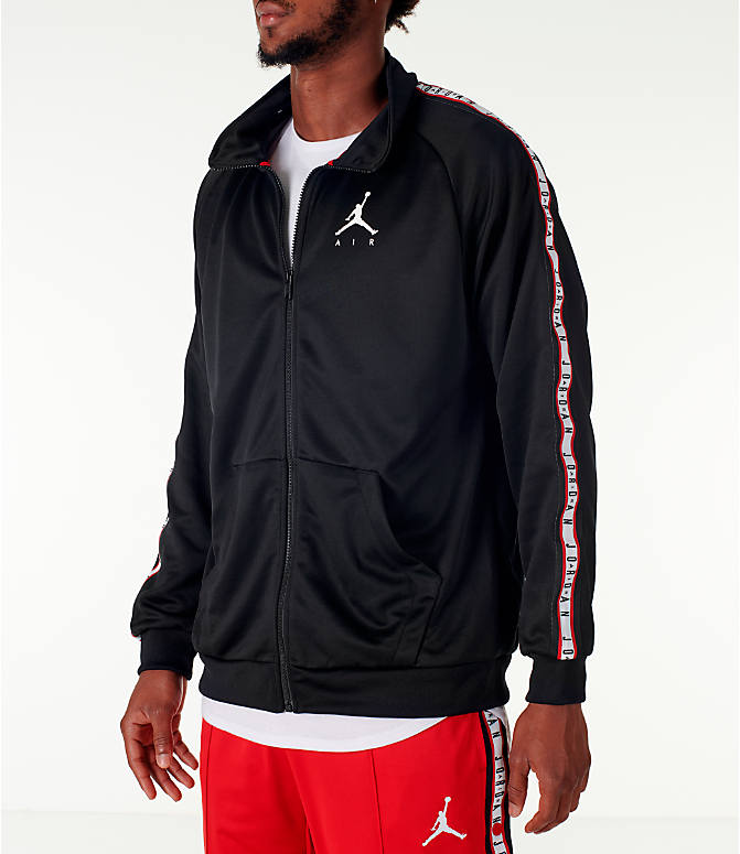 Front Three Quarter view of Men's Jordan Sportswear Jumpman Taped Tricot Jacket in Black