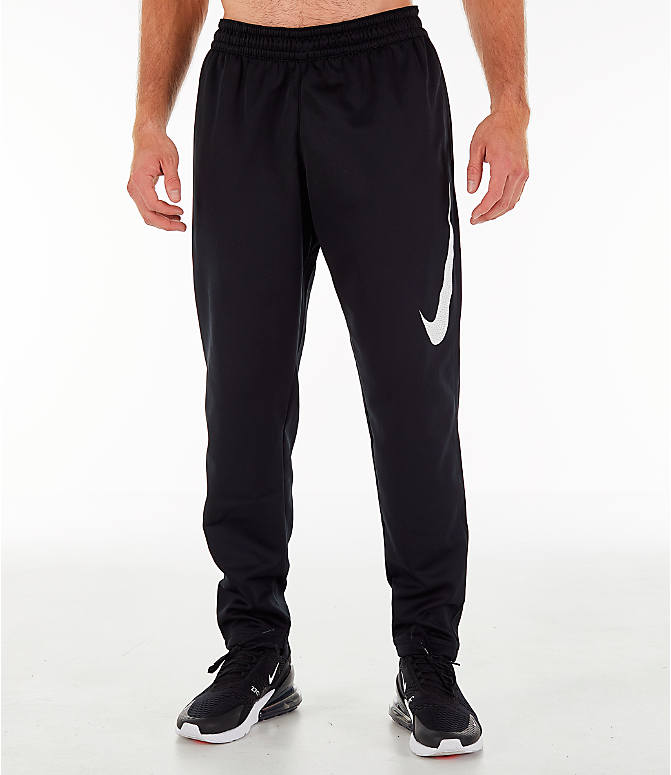 81306c63340f ... reduced front three quarter view of mens nike therma basketball pants  in black b36f6 9e518