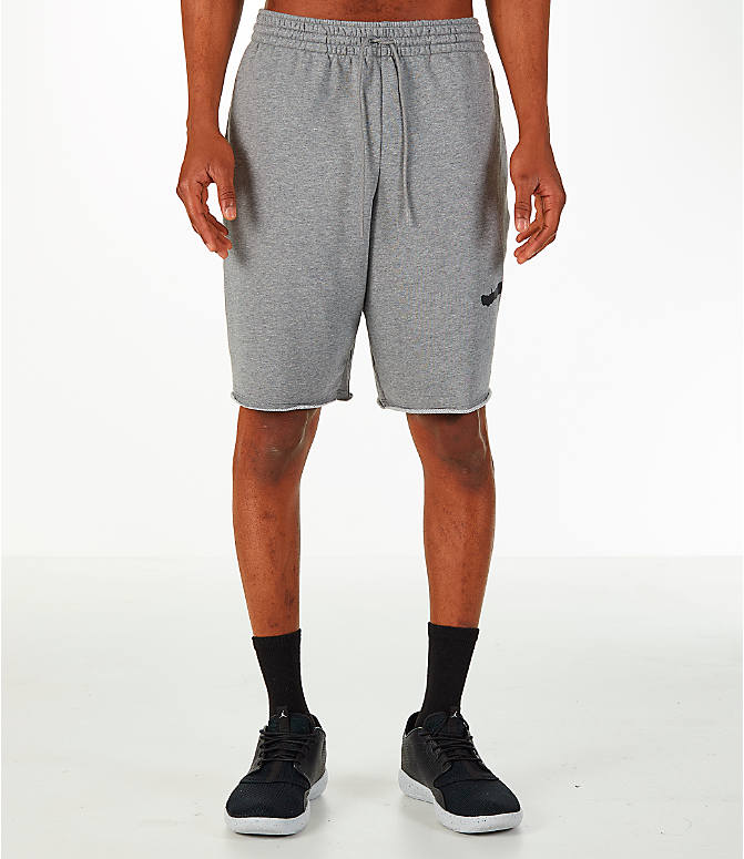 Front Three Quarter view of Men's Jordan Sportswear Air Jumpman Fleece Shorts in Carbon Heather/Black