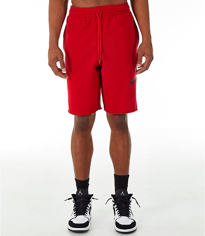 Front Three Quarter view of Men's Jordan Sportswear Air Jumpman Fleece Shorts in Gym Red