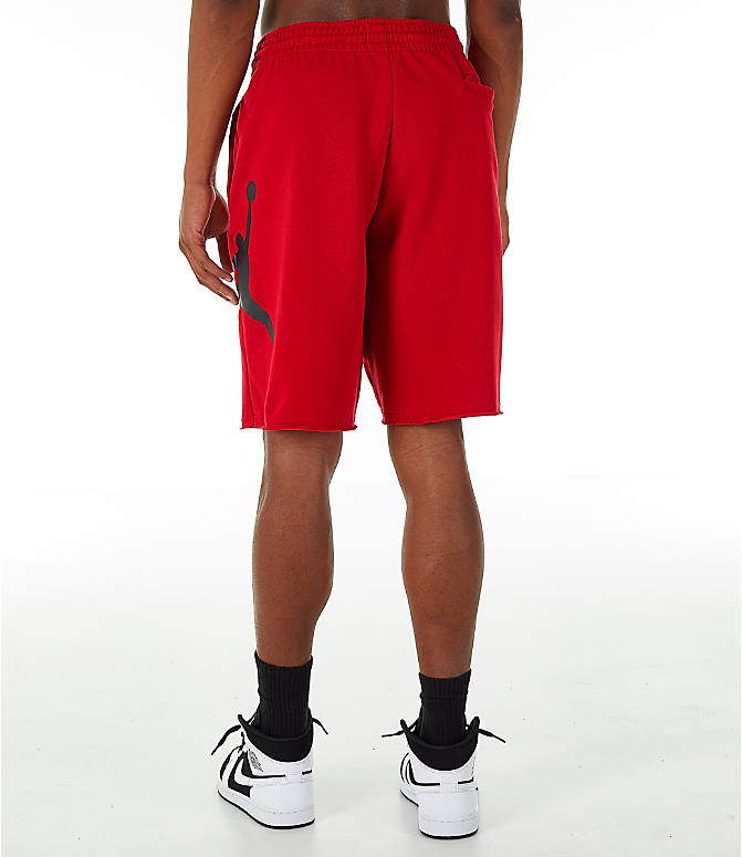 Back Left view of Men's Jordan Sportswear Air Jumpman Fleece Shorts in Gym Red