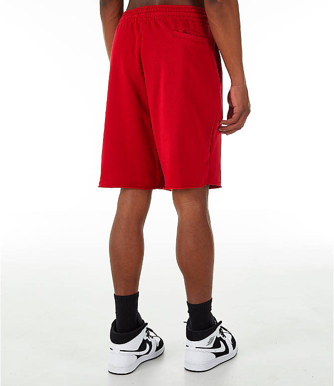 Back Right view of Men's Jordan Sportswear Air Jumpman Fleece Shorts in Gym Red