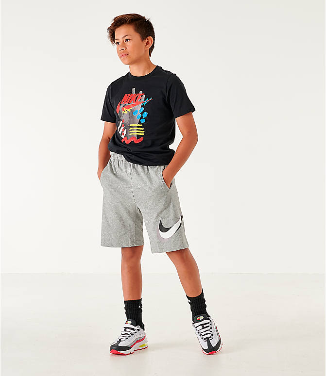 Front Three Quarter view of Boys' Nike Sportswear Core Jersey Shorts in Dark Grey Heather/Black