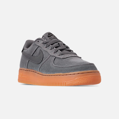 Three Quarter view of Boys' Big Kids' Nike Air Force 1 '07 LV8 Style Casual Shoes in Black/Black/Gum Medium Brown