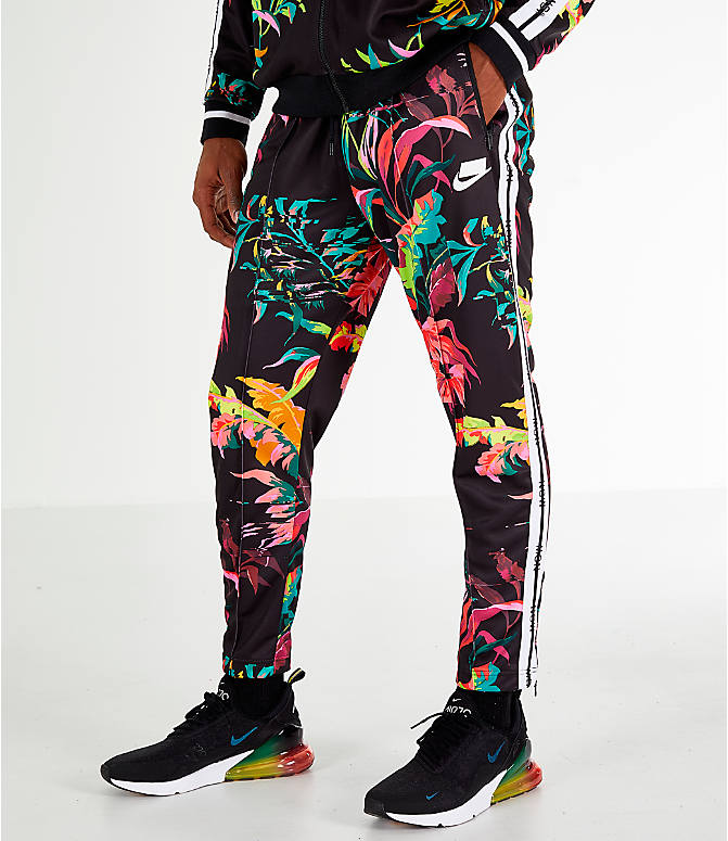 Front view of Men s Nike Sportswear Floral Track Pants in Cyber Black 2140ab0ee