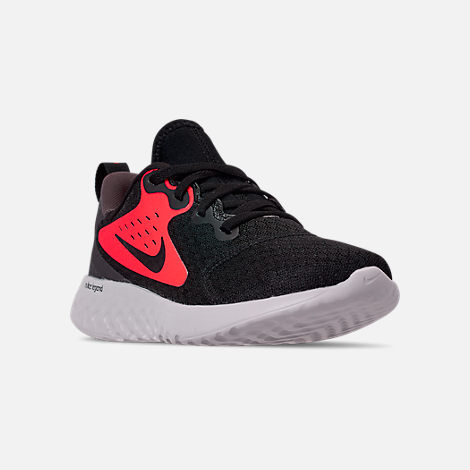 Three Quarter view of Boys' Little Kids' Nike Legend React Running Shoes in Black/Black/Flash Crimson/Thunder Grey