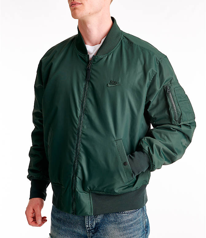 Front view of Men's Nike Sportswear Reversible Bomber Jacket in Outdoor Green/Gold Dart/White
