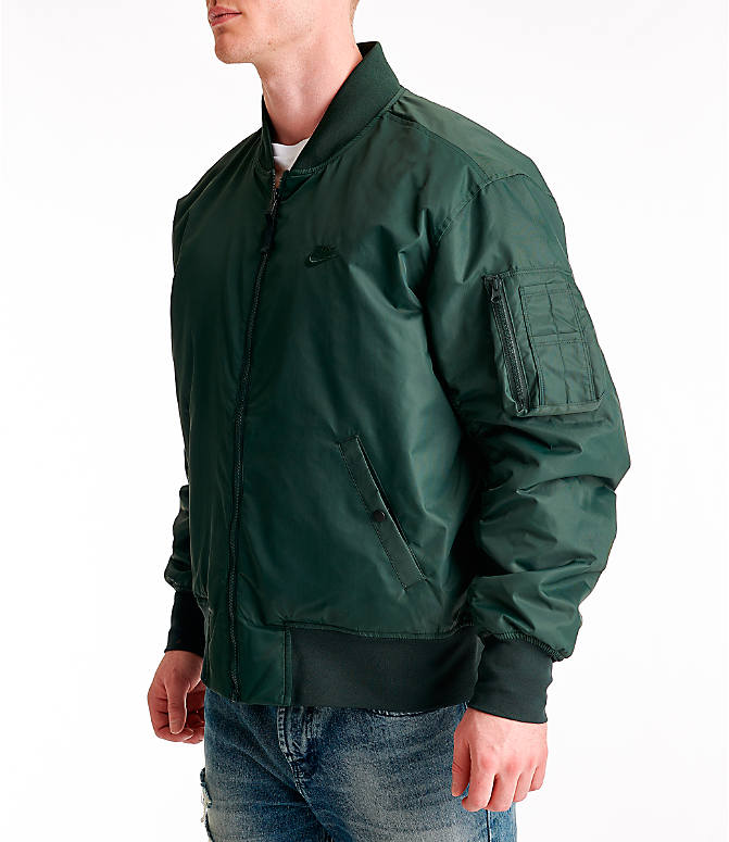 Front Three Quarter view of Men's Nike Sportswear Reversible Bomber Jacket in Outdoor Green/Gold Dart/White