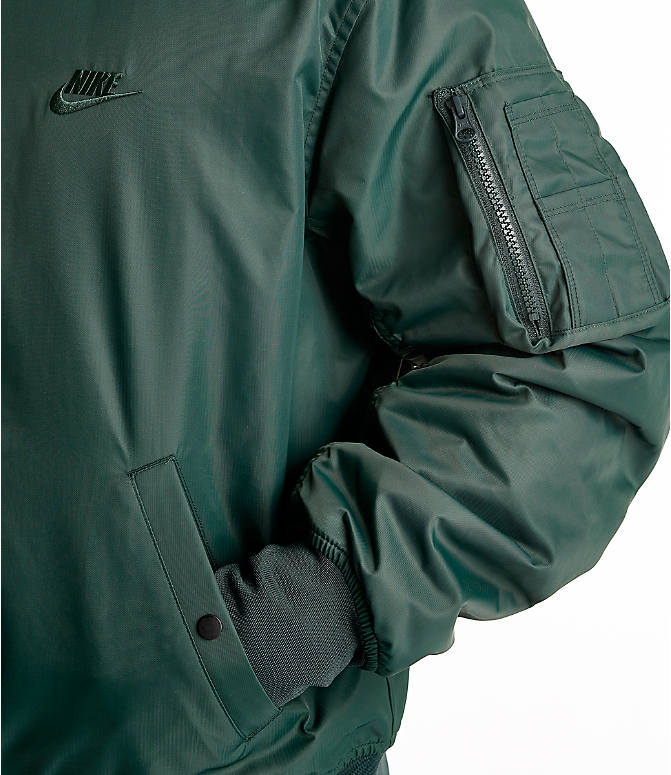Back Right view of Men's Nike Sportswear Reversible Bomber Jacket in Outdoor Green/Gold Dart/White