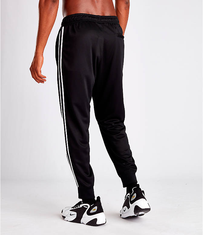 Back Left view of Men's Nike Sportswear Tribute Track Pants in Black