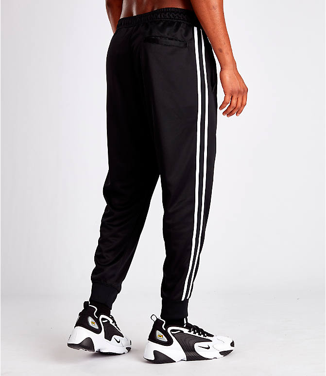Back Right view of Men's Nike Sportswear Tribute Track Pants in Black