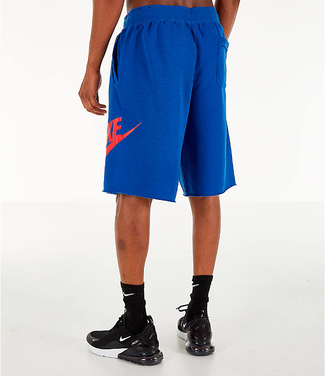 Back Left view of Men's Nike Sportswear Alumni Shorts in Indigo/Red