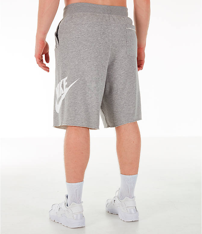 Back Left view of Men's Nike Sportswear Alumni Fleece Shorts in Dark Grey Heather/White