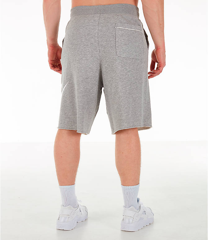 Back Right view of Men's Nike Sportswear Alumni Fleece Shorts in Dark Grey Heather/White