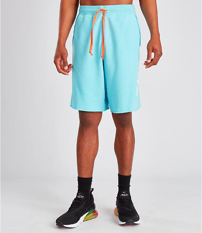 Front Three Quarter view of Men's Nike Sportswear Alumni Shorts in Blue Gaze
