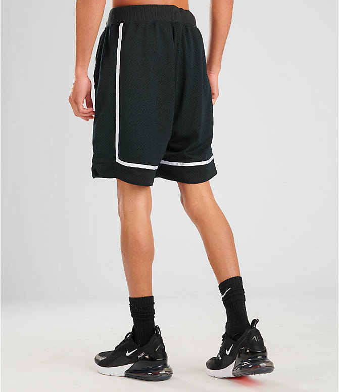Back Left view of Men's Nike Sportswear Statement Mesh Shorts in Black/White